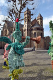 Maastricht basilica of Saint Servatius. The basilica of Saint Servatius and some carnival sculptures in Maastricht, the Netherlands Royalty Free Stock Photos