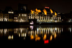 Maastricht Crowne Plaza Hotel by night with reflection. Maastricht by night with reflection in the maas Stock Images