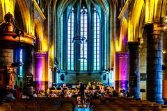 The Philharmonic Orchastra of the Maastricht Conservatorium practicing under director Jan Cober in the gothic St. John Church. Maastricht, Limburg / the royalty free stock images