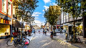 Shopping in the Maastrichter Brugstraat in the center of the historic city of Maastricht. Maastricht, Limburg / the Netherlands - Sept. 21, 2018: Shopping in the royalty free stock photo