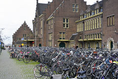 Maastricht, Netherlands - Bicycle parking. MAASTRICHT, NETHERLANDS - DECEMBER 29: Custom in many European countries. Hunderds of bicycles parked in front of the Stock Images