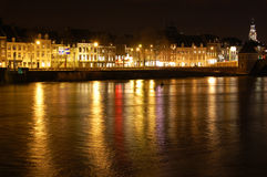 Maastricht at night. Colourful houses of the city of Maastricht at night along the river the Maas stock photo