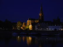 Maastricht at night, the Dutch city on the river Maas with boats Royalty Free Stock Images