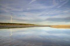 Maasvlakte beach with windmill Stock Photography