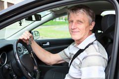 Maature man in own car Royalty Free Stock Image