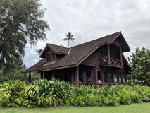 """Mabel Wilcox Hanalei Beach House. This beach house is a one-and-a-half story, wood-frame """"L"""" shaped house with board-and-batten walls, high-pitched royalty free stock images"""