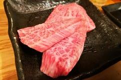 Mable premium grade Wagyu Japanese raw beef thick slice steak. Mable premium legendary grade Wagyu Japanese raw beef thick slice steak stock images