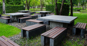 Mable table in public park. Mable table and bench in public park Stock Photo