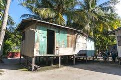 Mabul海岛的,沙巴, Malayia恶劣的木房子 免版税库存照片