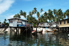Mabul island. A view of mabul island with dwellings,boats and palms in malaysian borneo.september 2010 Royalty Free Stock Photos