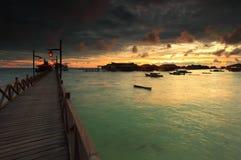 Mabul Island, Borneo, Sabah, Malaysia. Beautiful sunrise peeking through clouds at Mabul Island, Borneo, Sabah, Malaysia Stock Photos
