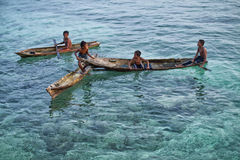 MABUL ISLAND, SABAH. local sea kids playing around at crystal clear water at Mabul Island Stock Photos