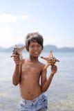 MABUL ISLAND, SABAH, MALAYSIA - MARCH 3: Local sea gypsy kid hol stock image