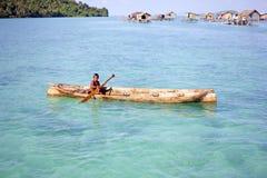 MABUL ISLAND, SABAH, MALAYSIA - MARCH 3: local sea gypsy kid pad Royalty Free Stock Photos