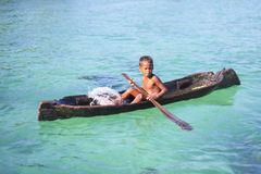 MABUL ISLAND, SABAH, MALAYSIA - MARCH 3: local sea gypsy kid pad Royalty Free Stock Photography