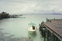 Mabul island. Mabul is a small island off the south-eastern coast of Sabah in Malaysia. The island has been a fishing village since the 1970s. Then in the 1990s Stock Photos