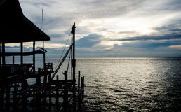Mabul Sunset Village Small Port. Small port area accessing to Mabul island. Over shadowing with cloud sunset Stock Image