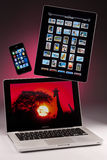 Mac Book Pro Laptop - iPhone 4S - iPad 2. A Apple Mac Book Pro laptop computer with an iPad 2 and an iPhone 4S Stock Image