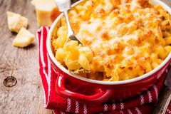 Mac and cheese, american style pasta. Mac and cheese, american style macaroni pasta in cheesy sauce royalty free stock image