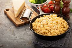 Mac and cheese in a cast iron pan. With steamed broccoli royalty free stock photography