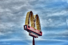Mac Donalds logo rusty and broken. Mac donalds logo rusty and destroyed after kateria storm Royalty Free Stock Image