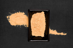 Maca powder on black background. Royalty Free Stock Images