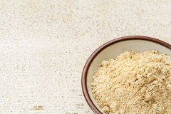 Maca root powder. (nutrition supplement - superfood from Andies) in a small ceramic bowl on a rustic barn wood Stock Photos