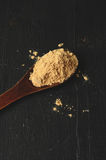 Maca root powder. In a wooden spoon Royalty Free Stock Image