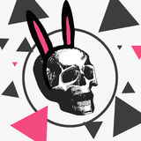 Macabre skull with a hoop with pink ears, different triangles Royalty Free Stock Photo