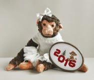 Macaco do brinquedo com ponto do bordado Imagens de Stock Royalty Free