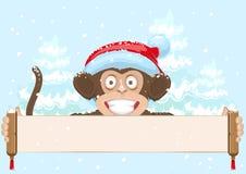 Macaco do Natal no símbolo do chapéu de Santa 2016 anos que guardam a bandeira Imagens de Stock