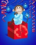 Macaco e presente Imagem de Stock Royalty Free