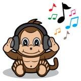 Macaco pequeno com fone de ouvido Foto de Stock Royalty Free