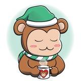 Macaco que relaxa com bebida quente Fotografia de Stock Royalty Free