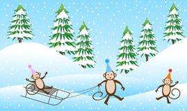 Macaco três alegre que sledding na floresta do inverno ilustração stock