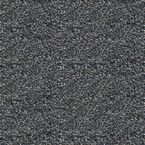 Macadam with asphalt seamless background. Macadam with asphalt under sunlight black seamless textured background Royalty Free Stock Image