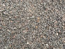 Macadam, crushed stone texture. May be used as background Royalty Free Stock Image