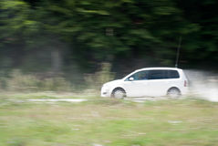 Macadam drive. Driving a fast white car on the macadam Stock Photography