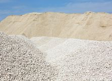 Macadam. Of fine gravel hills against the sky Royalty Free Stock Image