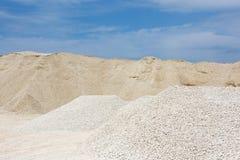 Macadam. Of fine gravel hills against the sky Stock Photo