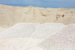 Macadam. Of fine gravel hills against the sky Stock Images