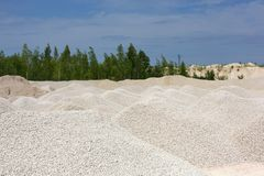 Macadam. Of fine gravel hills against the sky Royalty Free Stock Photo