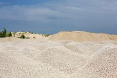 Macadam. Of fine gravel hills against the sky Royalty Free Stock Photography