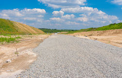 Macadam layer on an unfinished highway. Near Dnepropetrovsk city in Ukraine Stock Images
