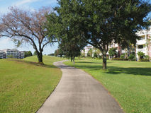 Macadam path by a golf course. Macadam path or walkway by a golf course and trees Royalty Free Stock Photography