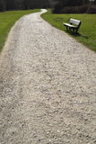 Macadam. Road and bench in Trent Park, London Royalty Free Stock Image
