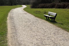 Macadam. Road and bench in Trent Park, London Stock Image