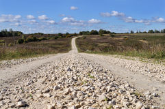 Macadam road through the hills. Rural landscape with macadam road through the hills, sunny autumn day Stock Images