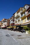 Macadam road with houses and restaurants in Villefranche Sur Meer in France. Vertical photo of macadam road with houses and restaurants in Villefranche Sur Meer Stock Images