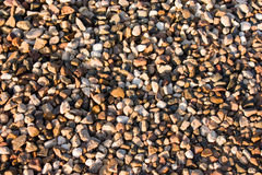 Macadam texture. Colored macadam texture under sunlight Stock Image
